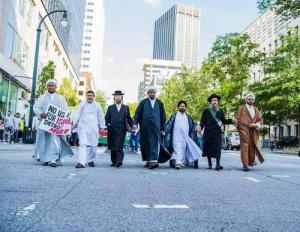 USA-- Detroit .. Just need to be human to stand up for another human Jews & Muslims hand in hand  in Detroit  مسلم يهودى ايد واحدة  !!!