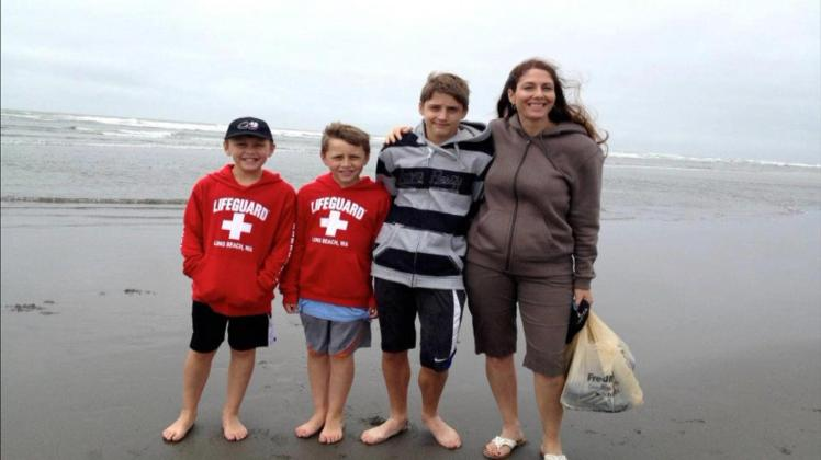 Tori Rains-Wedan, right, with sons Mason, Austin and Hunter (courtesy to CBS4)